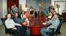 Group Photo of Adobe Associates Staff in Conference Room