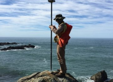 Dan at Stewarts Point - Land Surveying for a USGS Benchmark on the Northern California Coast