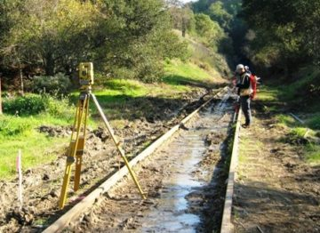 Surveyor on Sonoma-Marin Area Rail Transit Track