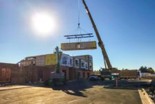 Modular Hotel Rooms Being Placed by Crane
